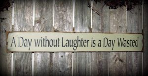 a_day_without_laughter_is_a_day_wasted__inspirational_-_laughter_sign_d42b8dc9