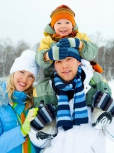 6027456-happy-young-family-spending-time-outdoor-in-winter-park