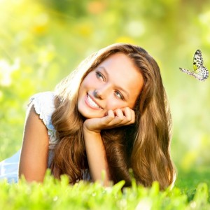 happy-woman-butterfly-nature