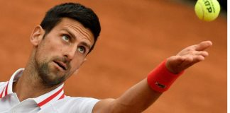 novak with tennis ball